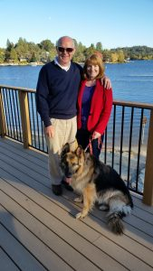 Gemma long-coat female German shepherd dog with owners Bryan and Colleen Hall